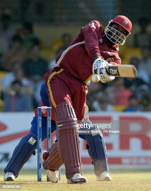 Wets Indies' Chris Gayle hits out during the ICC Champions Trophy match at the Sardar Patel Stadium Ahmedabad India