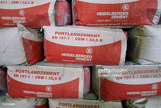 FILES A picture taken 31 July 2003 shows cement bags piled up at the plant of German cement maker HeidelbergCement in Wetzlar western Germany...