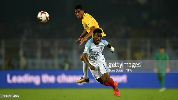 Weverson of Brazil and Callum HudsonOdoi of England in action during the FIFA U17 World Cup India 2017 Semi Final match between Brazil and England at...
