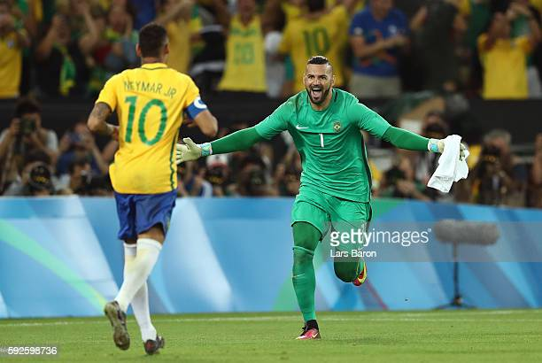 Weverton and Neymar of Brazil celebrate after the Men's Football Final between Brazil and Germany at the Maracana Stadium on Day 15 of the Rio 2016...