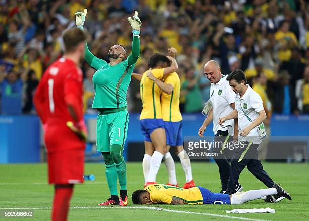 Weverton and Neymar of Brazil celebrates after the Men's Football Final between Brazil and Germany at the Maracana Stadium on Day 15 of the Rio 2016...