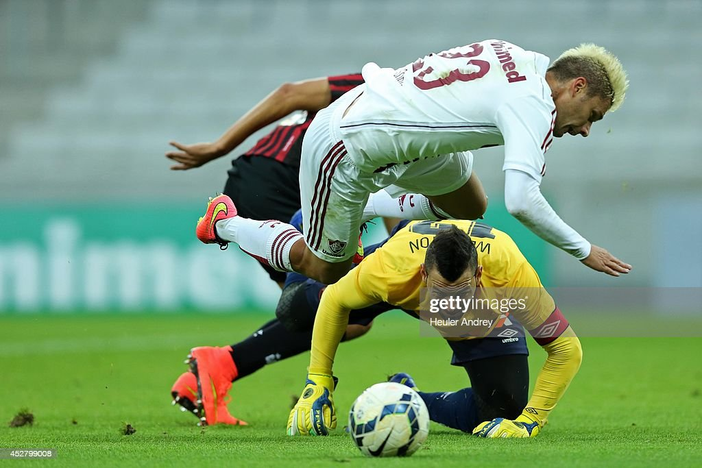 Weverton of Atletico-PR competes for the ball with <a gi-track='captionPersonalityLinkClicked' href=/galleries/search?phrase=Rafael+Sobis&family=editorial&specificpeople=682143 ng-click='$event.stopPropagation()'>Rafael Sobis</a> of Fluminense during the match between Atletico-PR and Fluminense for the Brazilian Series A 2014 at Arena da Baixada on July 27, 2014 in Curitiba, Brazil.