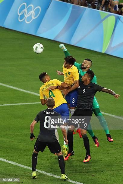 Weverton of Brazil Rodrigo Caio of Brazil Marquinhos of Brazil Davie Selke of Germany and Lars Bender of Germany challenge during the Men's Football...