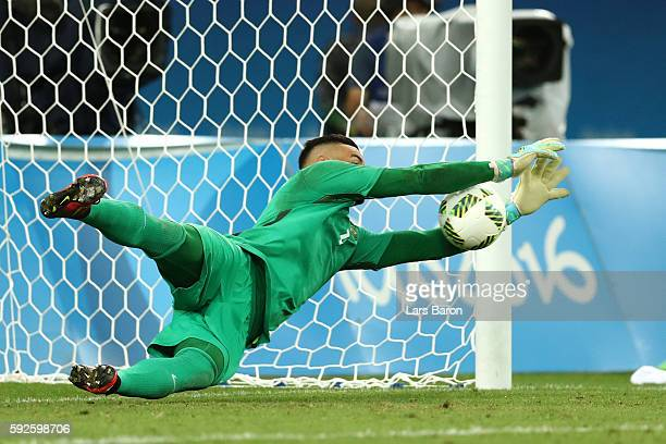Weverton of Brazil saves Germany's final penalty during the Men's Football Final between Brazil and Germany at the Maracana Stadium on Day 15 of the...