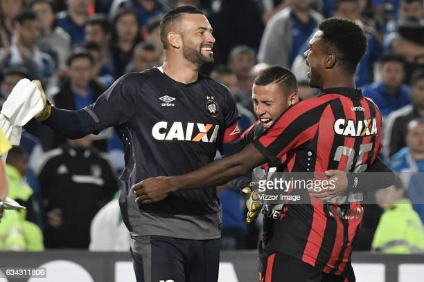 Weverton Sidcley and Wanderson of Atletico Paranaense celebrate after a match between Millonarios and Atletico Paranaense as part of Copa...