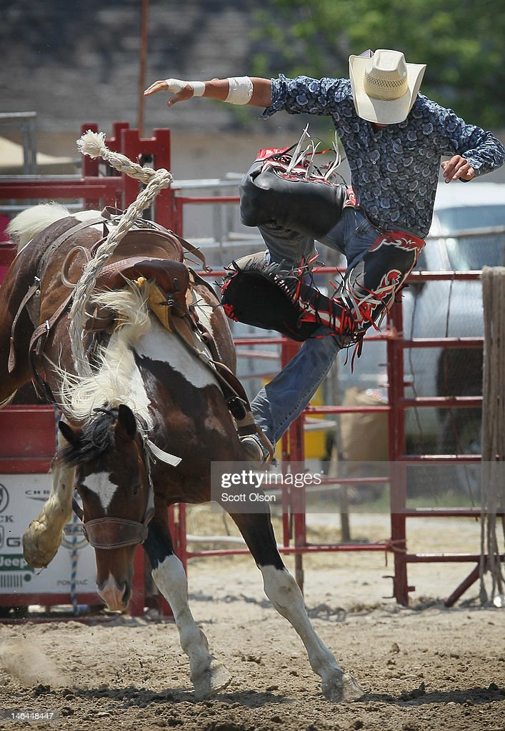 Whalen Pickerill gets tossed from his horse as he competes in the saddle bronc riding competition at the Illinois High School Rodeo Association State Finals on June 16, 2012 in Altamont, Illinois. Winners in the competition will go on to compete in the high school national championships July 15-21 in Rock Springs, Wyoming.