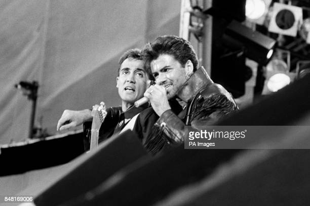 Wham who are Andrew Ridgeley and George Michael live on stage during their farewell concert
