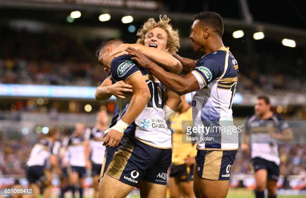 Wharenui Hawera of the Brumbies is congratulated by teeam mates after scoring a try during the round three Super Rugby match between the Brumbies and...
