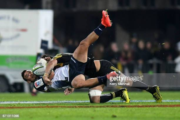 Wharenui Hawera of the Brumbies is tackled by Ardie Savea of the Hurricanes during the round nine Super Rugby match between the Hurricanes and the...