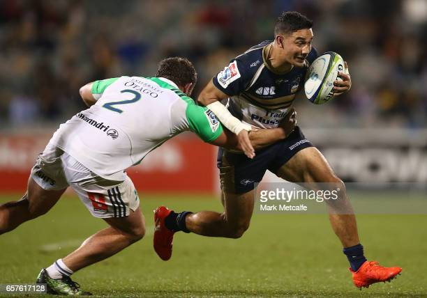 Wharenui Hawera of the Brumbies is tackled by Liam Coltman of the Highlanders during the round five Super Rugby match between the Brumbies and the...