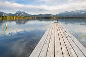 Wharf on Hopfensee lake, near Fuessen, East Allgaeu, Bavaria, Germany