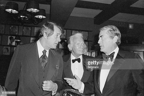 What a cast But this is pleasure not business Actors Rock Hudson Douglas Fairbanks Jr and Gregory Peck attend a party at Sardi's in New York to...
