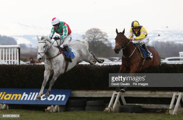 What a Warrior ridden by Sam Twiston Davies on their way to winning the Alfa Aggregates Products Novices' Chase ahead of Elenika ridden by Daryl...