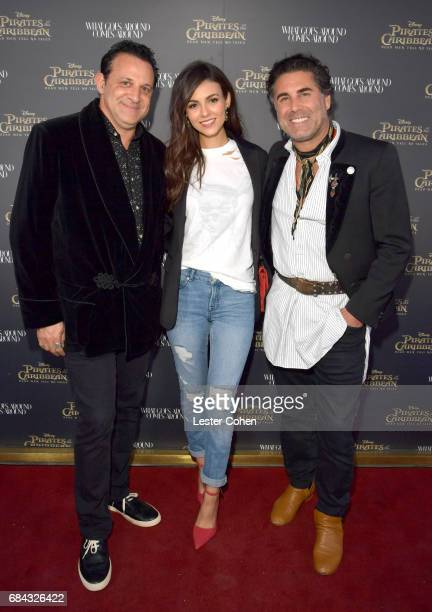 What Goes Around Comes Around CoFounders Seth Weisser and Gerard Maione pose with singer/actress Victoria Justice at the Pirates of the Caribbean...