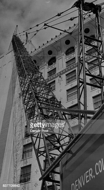 What Goes Up You've seen those derricks on the top of multistory buildings under construction—and wondered how workmen got them down when the job was...