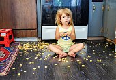 Toddler spills a snack all over the floor, but seems content to eat it anyways
