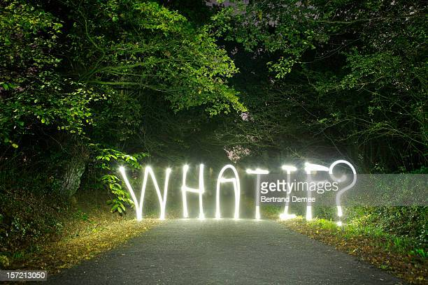 'What if ?' written in light across a road
