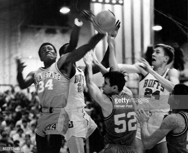 What we need are a Few More Hands Bob Buck of Oklahoma State got through this maze of outstretched arms to pull down a rebound during firsthalf...