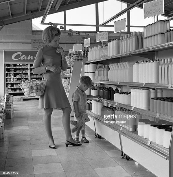 'Whats in it for me' 1965 A press advertisement photo taken in 1965 showing a child and mother deep in thought whilst looking at supermarket shelves...