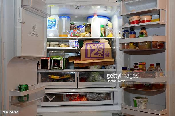 What's in the fridge Refrigerator filled with both healthy and junk food