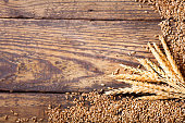 wheat ears and grains on a wooden table