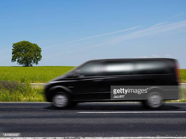 Wheat fields and black van
