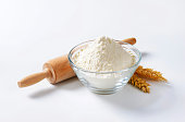 Bowl of flour, rolling pin and wheat ears