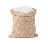 flour in burlap sack bag isolated on white background