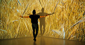 Wheat projection upon a male dancer.