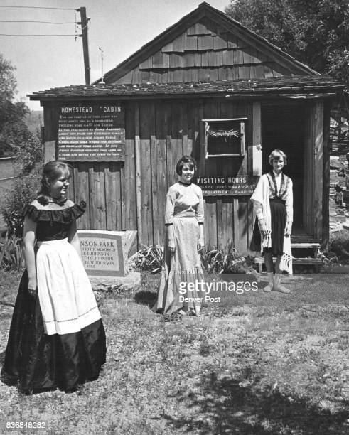 Wheat Ridge Park Features Museum Teenaged girls are ready to guide visitors through the Judge Johnson Cabin Museum at Johnson Park in Wheat Ridge...