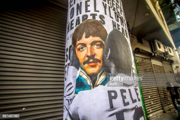 A wheatpaste piece of street art by artist Luis Bueno Shows soccer player Pelé kissing singer Paul McCartney Today June 18 one of the most...