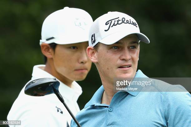 Whee Kim of Korea and Bud Cauley of the United States look on from the 13th tee during the second round of the Travelers Championship at TPC River...