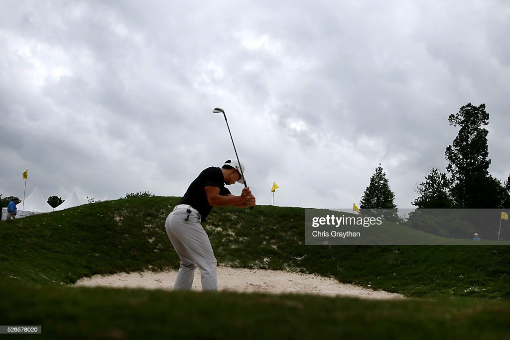 Whee Kim of Korea takes his shot out of the bunker on the practice range during the third round of the Zurich Classic at TPC Louisiana on April 30, 2016 in Avondale, Louisiana.