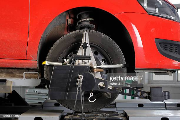 Wheel alignment and balancing with computer