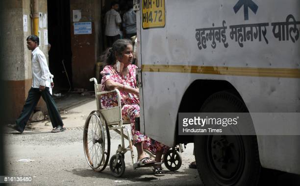 A wheel chair borne patient waits endlessly outside KEM hospital in Parel as hundreds of lower rung staff went on strike demanding sixth pay...