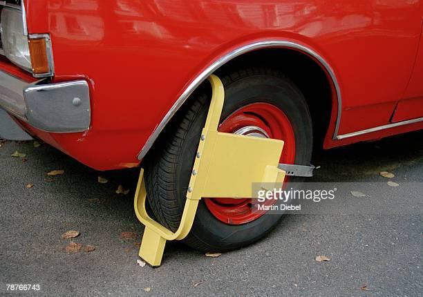 Wheel clamp on wheel of car