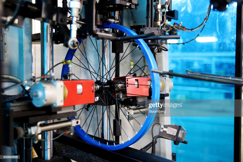 A wheel frame sits in a trueing robot at The Kent International Inc. Bicycle Corporation of America brand Assembly facility in Manning, South Carolina, U.S., on Sunday, June 25, 2017. Almost all of the roughly 18 million bicycles sold each year in the U.S. come from China and Taiwan. This year, about 130 workers at the Bicycle Corporation of America's new factory will assemble 350,000 bikes in the U.S. Photographer: Travis Dove/Bloomberg via Getty Images
