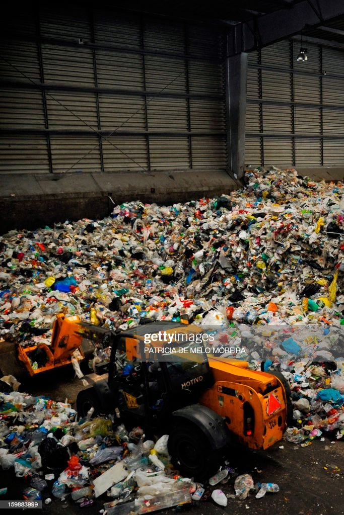 A wheel loader lifts garbage for recycling at Valorsul, a waste treatment plant, in Lisbon on January 22, 2013.