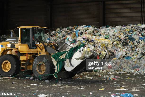A wheel loader moves discarded plastics and other materials at the ALBA sorting center for the recycling of packaging materials on August 15 2017 in...