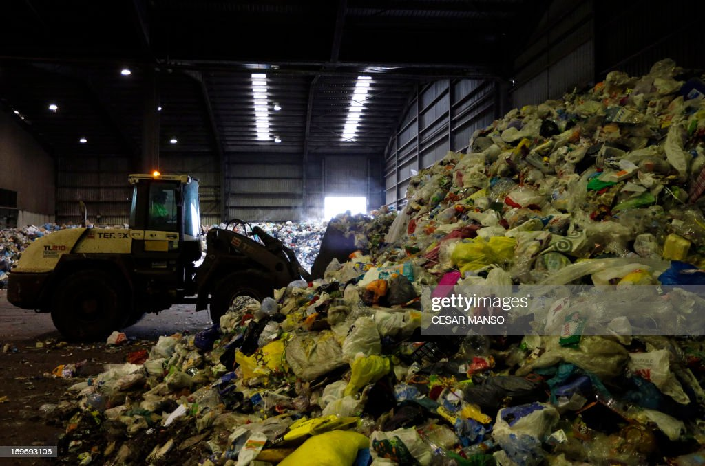 A wheel loader remove garbage for recycling at a waste treatment plant in Burgos on January 18, 2013.