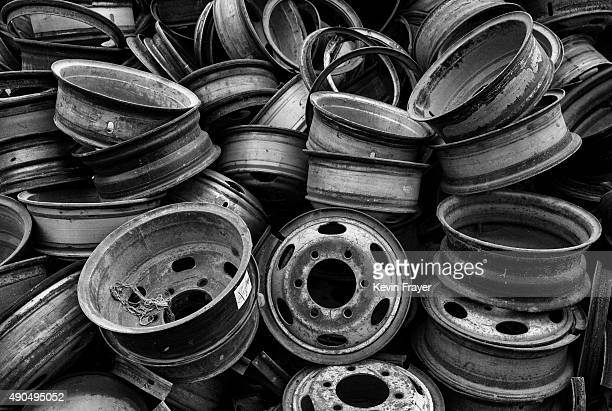 Wheel rims from high polluting vehicles taken off the road by authorities are seen piled up at an auto scrapyard on September 25 2015 in Zhejiang...