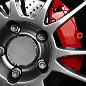 Sports car rims with red brake calipers