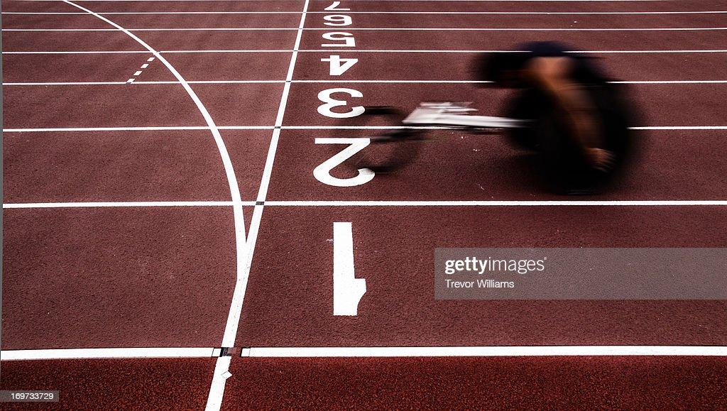 Wheelchair athlete racing : Stock Photo
