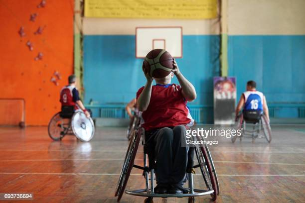 Wheelchair athlete shooting basketball