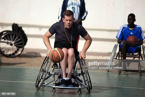 US Wheelchair Basketball coach Jess Markt trains South Sudanese basketball wheelchair players train at the Juba Basketball Court on January 11 2017...
