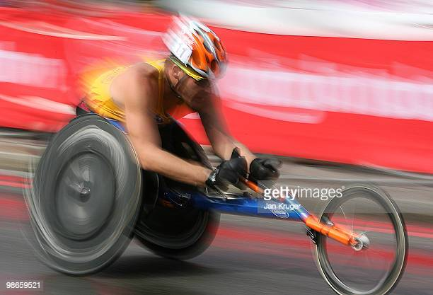 A wheelchair competitor is seen racing over Tower Bridge during the 2010 Virgin London Marathon on April 25 2010 in London England