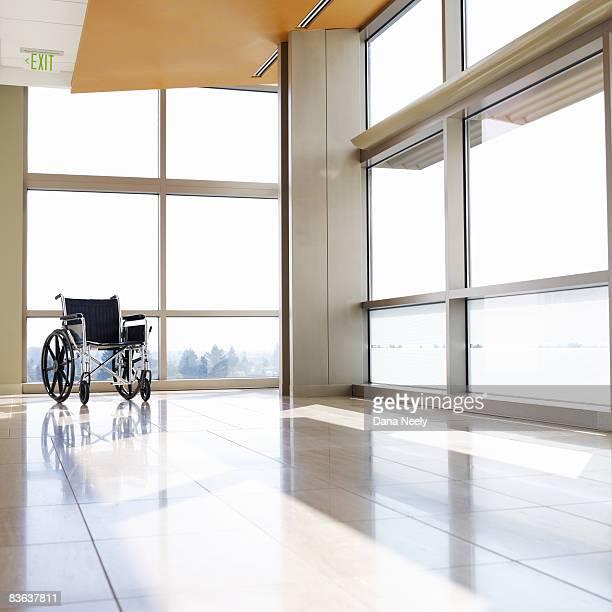 Wheelchair in empty hospital corridor