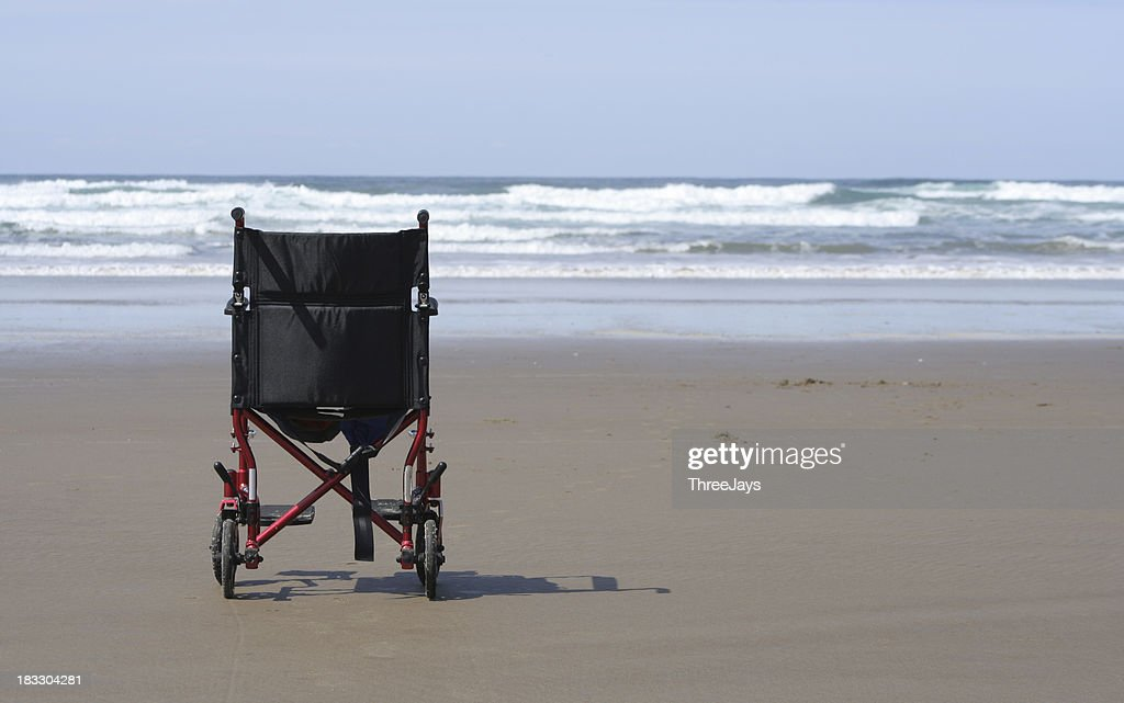 Wheelchair on the Beach : Stock Photo