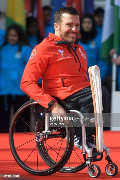 Wheelchair Racer and Paralympian Kurt Fearnley of Australia with the baton during the launch of The Queen's Baton Relay for the XXI Commonwealth...