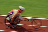 Wheelchair racer on track, side view